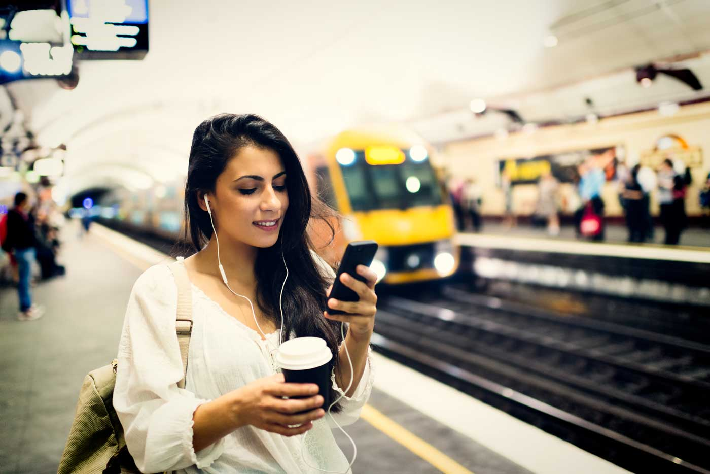 Woman at trainstation with phone